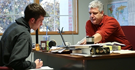 instructor meeting with student in office